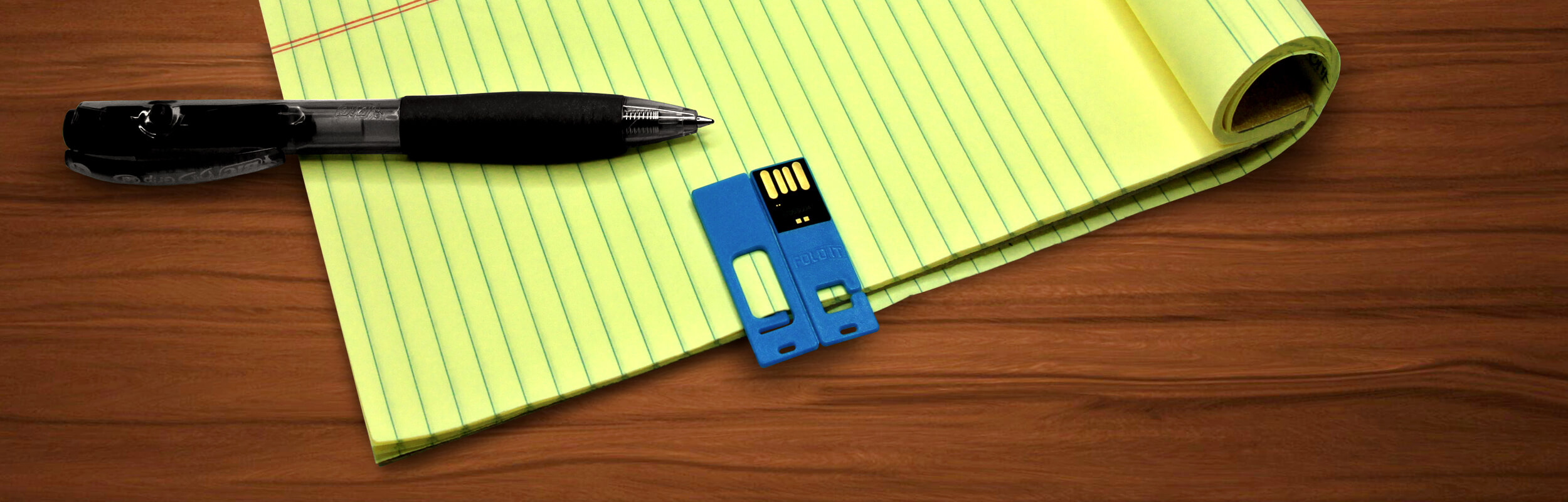 FoldIT® USB Flash Drive Clipped to Notepad